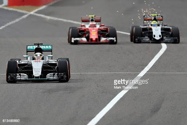 Lewis Hamilton of Great Britain driving the Mercedes AMG Petronas F1 Team Mercedes F1 WO7 Mercedes PU106C Hybrid turbo leads Kimi Raikkonen of...