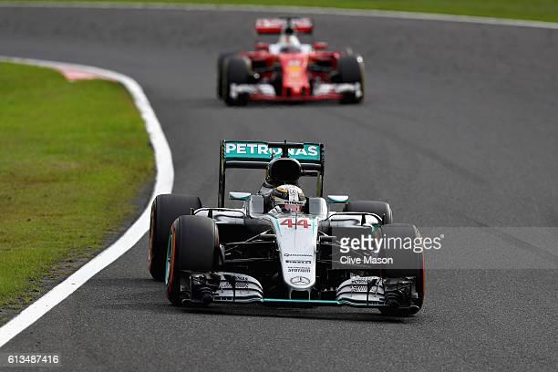 Lewis Hamilton of Great Britain driving the Mercedes AMG Petronas F1 Team Mercedes F1 WO7 Mercedes PU106C Hybrid turbo leads Sebastian Vettel of...