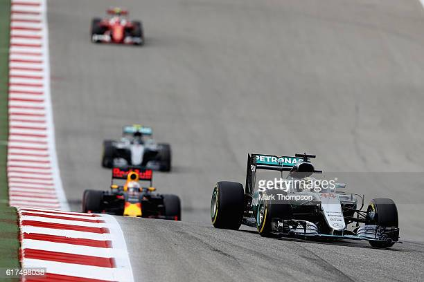Lewis Hamilton of Great Britain driving the Mercedes AMG Petronas F1 Team Mercedes F1 WO7 Mercedes PU106C Hybrid turbo leads Daniel Ricciardo of...
