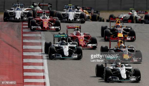 Lewis Hamilton of Great Britain driving the Mercedes AMG Petronas F1 Team Mercedes F1 WO7 Mercedes PU106C Hybrid turbo leads Nico Rosberg of Germany...