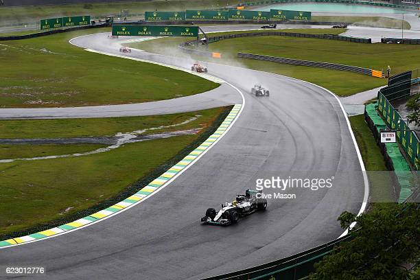 Lewis Hamilton of Great Britain driving the Mercedes AMG Petronas F1 Team Mercedes F1 WO7 Mercedes PU106C Hybrid turbo leads the field during the...
