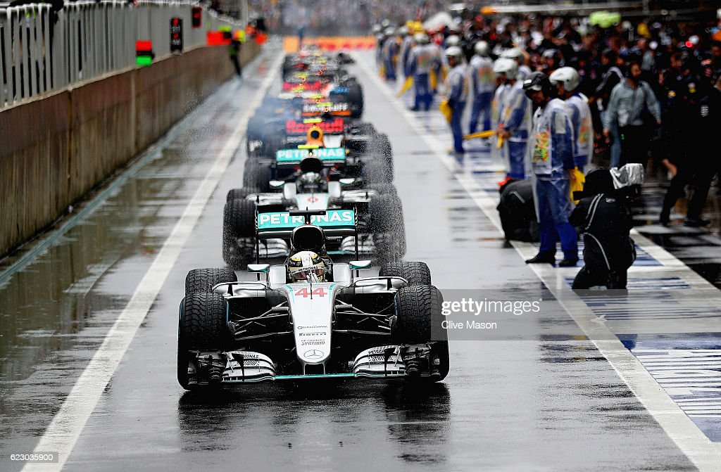 Lewis Hamilton of Great Britain driving the (44) Mercedes AMG Petronas F1 Team Mercedes F1 WO7 Mercedes PU106C Hybrid turbo leads the entire field in the Pitlane in a red flag period during the Formula One Grand Prix of Brazil at Autodromo Jose Carlos Pace on November 13, 2016 in Sao Paulo, Brazil.