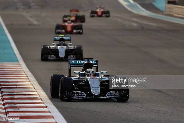Lewis Hamilton of Great Britain driving the Mercedes AMG Petronas F1 Team Mercedes F1 WO7 Mercedes PU106C Hybrid turbo neads Nico Rosberg of Germany...