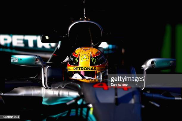 Lewis Hamilton of Great Britain driving the Mercedes AMG Petronas F1 Team Mercedes F1 WO8 leaves the garage during day one of Formula One winter...