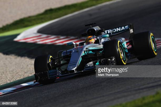 Lewis Hamilton of Great Britain driving the Mercedes AMG Petronas F1 Team Mercedes F1 WO8 on track during day one of Formula One winter testing at...