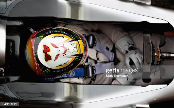 Lewis Hamilton of Great Britain driving the Mercedes AMG Petronas F1 Team Mercedes F1 WO8 sits in his car in the Pitlane during day two of Formula...