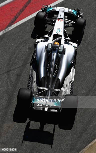 Lewis Hamilton of Great Britain driving the Mercedes AMG Petronas F1 Team Mercedes F1 WO8 in the Pitlane during day three of Formula One winter...