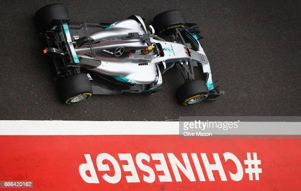 Lewis Hamilton of Great Britain driving the Mercedes AMG Petronas F1 Team Mercedes F1 WO8 in the Pitlane during the Formula One Grand Prix of China...