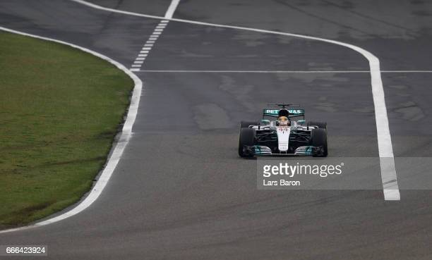 Lewis Hamilton of Great Britain driving the Mercedes AMG Petronas F1 Team Mercedes F1 WO8 leaves the pit lane during the Formula One Grand Prix of...