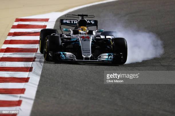 Lewis Hamilton of Great Britain driving the Mercedes AMG Petronas F1 Team Mercedes F1 WO8 locks a wheel under braking during the Bahrain Formula One...