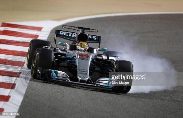 Lewis Hamilton of Great Britain driving the Mercedes AMG Petronas F1 Team Mercedes F1 WO8 locks a wheel under braking during the Bahrain Formula One...