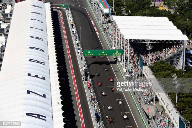 Lewis Hamilton of Great Britain driving the Mercedes AMG Petronas F1 Team Mercedes F1 WO8 leads the field away at the start during the Azerbaijan...