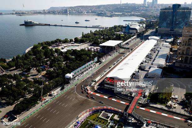 Lewis Hamilton of Great Britain driving the Mercedes AMG Petronas F1 Team Mercedes F1 WO8 leads the field round the first corner during the...