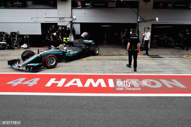 Lewis Hamilton of Great Britain driving the Mercedes AMG Petronas F1 Team Mercedes F1 WO8 leaves thre garage during qualifying for the Formula One...