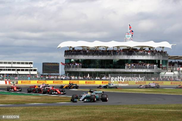 Lewis Hamilton of Great Britain driving the Mercedes AMG Petronas F1 Team Mercedes F1 WO8 lead at the start during the Formula One Grand Prix of...