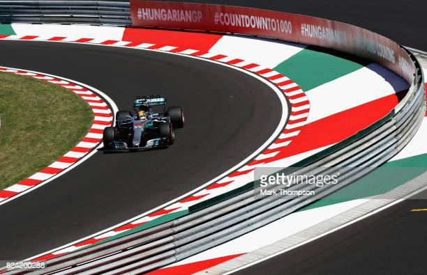 Lewis Hamilton of Great Britain driving the Mercedes AMG Petronas F1 Team Mercedes F1 WO8 enters the pitlane during qualifying for the Formula One...