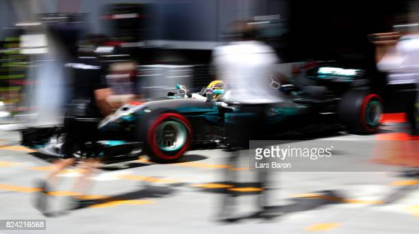 Lewis Hamilton of Great Britain driving the Mercedes AMG Petronas F1 Team Mercedes F1 WO8 leaves the garage during qualifying for the Formula One...