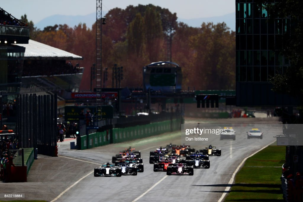 Lewis Hamilton of Great Britain driving the (44) Mercedes AMG Petronas F1 Team Mercedes F1 WO8 leads the field into the first corner at the start during the Formula One Grand Prix of Italy at Autodromo di Monza on September 3, 2017 in Monza, Italy.