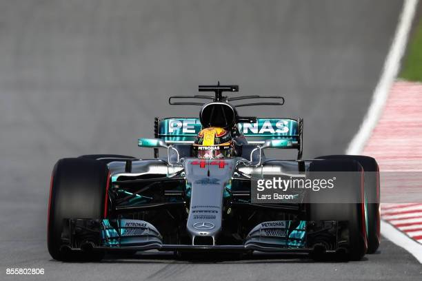 Lewis Hamilton of Great Britain driving the Mercedes AMG Petronas F1 Team Mercedes F1 WO8 on track during qualifying for the Malaysia Formula One...