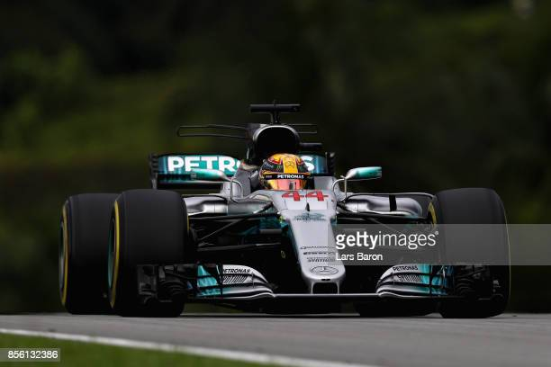 Lewis Hamilton of Great Britain driving the Mercedes AMG Petronas F1 Team Mercedes F1 WO8 on track during the Malaysia Formula One Grand Prix at...