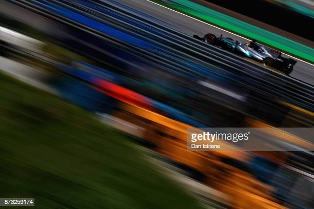 Lewis Hamilton of Great Britain driving the Mercedes AMG Petronas F1 Team Mercedes F1 WO8 on track during the Formula One Grand Prix of Brazil at...