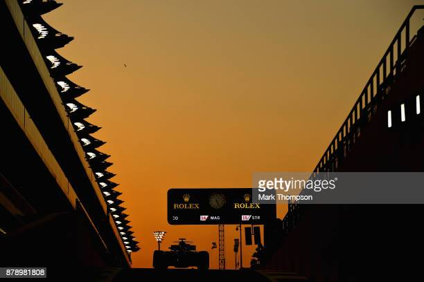 Lewis Hamilton of Great Britain driving the Mercedes AMG Petronas F1 Team Mercedes F1 WO8 in the Pitlane during qualifying for the Abu Dhabi Formula...
