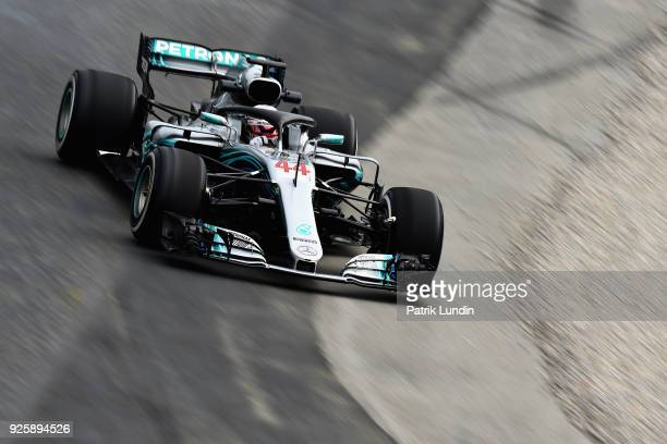 Lewis Hamilton of Great Britain driving the Mercedes AMG Petronas F1 Team Mercedes WO9 runs wide during day four of F1 Winter Testing at Circuit de...