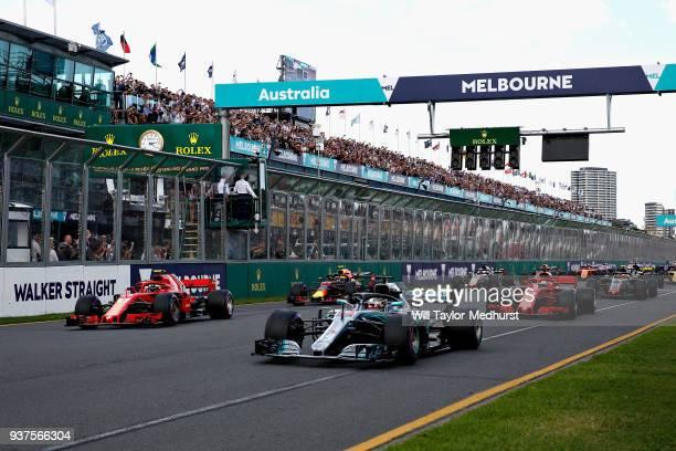 Lewis Hamilton of Great Britain driving the Mercedes AMG Petronas F1 Team Mercedes WO9 leads Kimi Raikkonen of Finland driving the Scuderia Ferrari...
