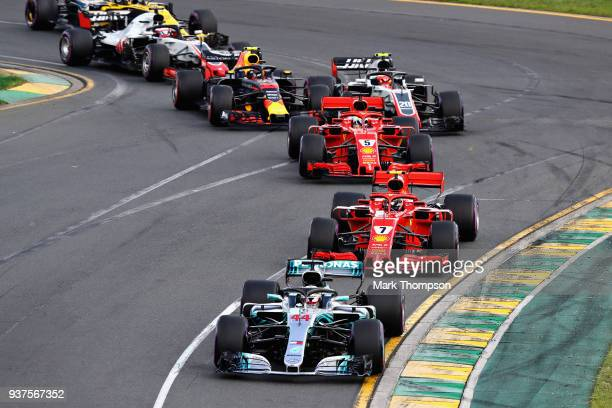 Lewis Hamilton of Great Britain driving the Mercedes AMG Petronas F1 Team Mercedes WO9 leads Kimi Raikkonen of Finland driving the Scuderia Ferrari...