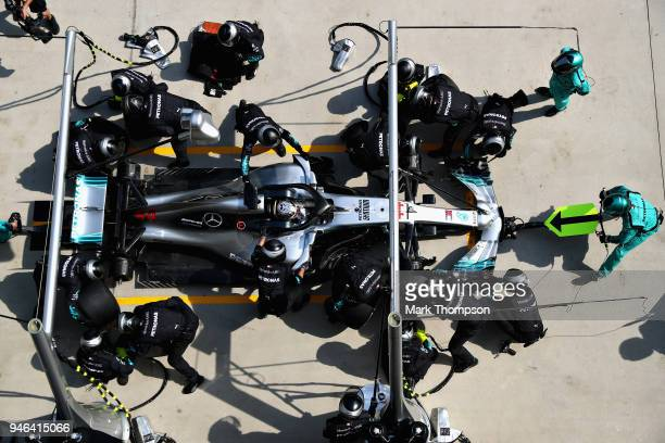 Lewis Hamilton of Great Britain driving the Mercedes AMG Petronas F1 Team Mercedes WO9 makes a pit stop for new tyres during the Formula One Grand...