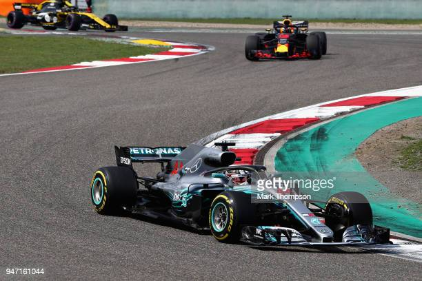 Lewis Hamilton of Great Britain driving the Mercedes AMG Petronas F1 Team Mercedes WO9 leads Daniel Ricciardo of Australia driving the Aston Martin...