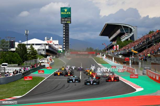 Lewis Hamilton of Great Britain driving the Mercedes AMG Petronas F1 Team Mercedes WO9 leads the field at the start during the Spanish Formula One...
