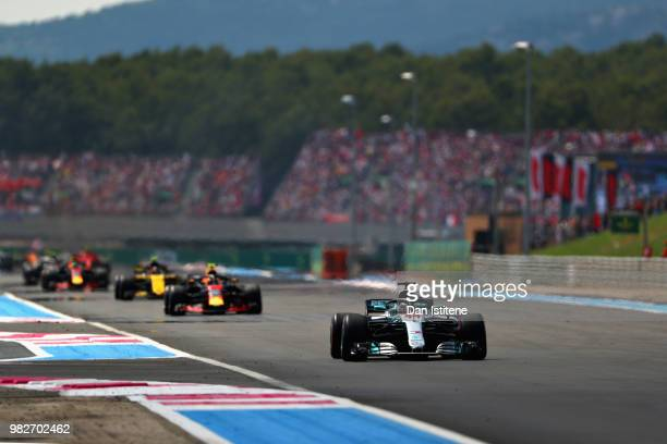 Lewis Hamilton of Great Britain driving the Mercedes AMG Petronas F1 Team Mercedes WO9 leads the field at the start during the Formula One Grand Prix...