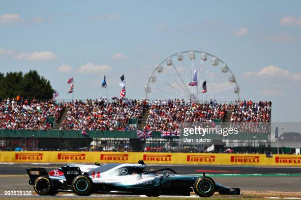 Lewis Hamilton of Great Britain driving the Mercedes AMG Petronas F1 Team Mercedes WO9 overtakes Sergey Sirotkin of Russia driving the Williams...
