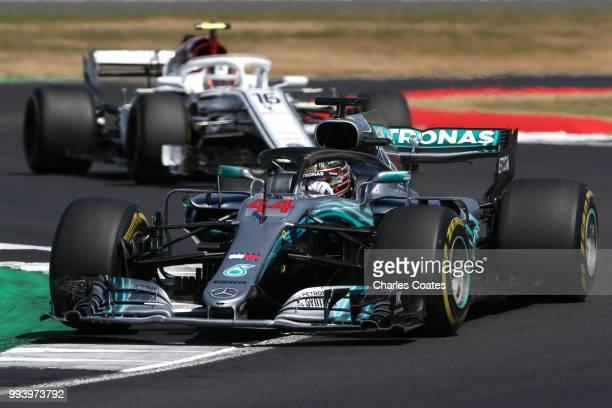 Lewis Hamilton of Great Britain driving the Mercedes AMG Petronas F1 Team Mercedes WO9 leads Charles Leclerc of Monaco driving the Alfa Romeo Sauber...