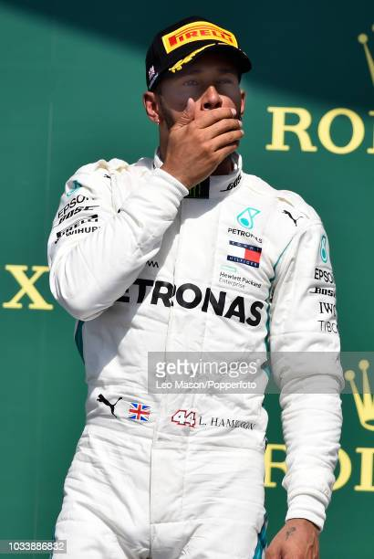 Lewis Hamilton of Great Britain on the podium after finishing 3rd during the British F1 Grand Prix at Silverstone Circuit on July 8 2018 in...
