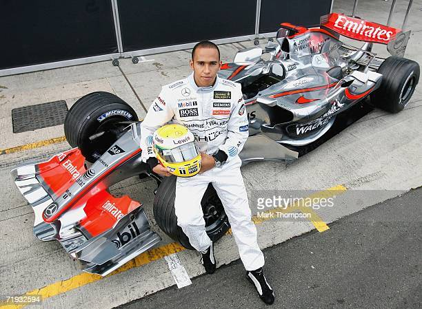 Lewis Hamilton of Great Britain poses beside the McClaren MP421 car as he prepares to drive it for the first time during Formula one testing at...