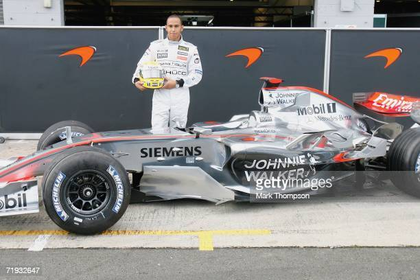 Lewis Hamilton of Great Britain poses beside the McClaren MP421 car as he prepares to drive it for the first time, during Formula one testing at...
