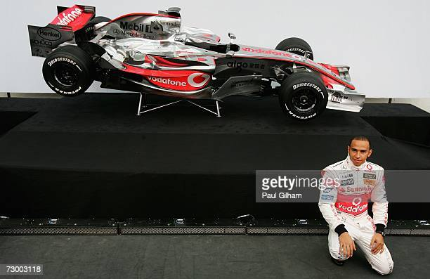 Lewis Hamilton of Great Britain poses for the media during the launch of the Vodafone McLaren Mercedes 2007 MP422 F1 challenger at L'Heisferic Ciudad...