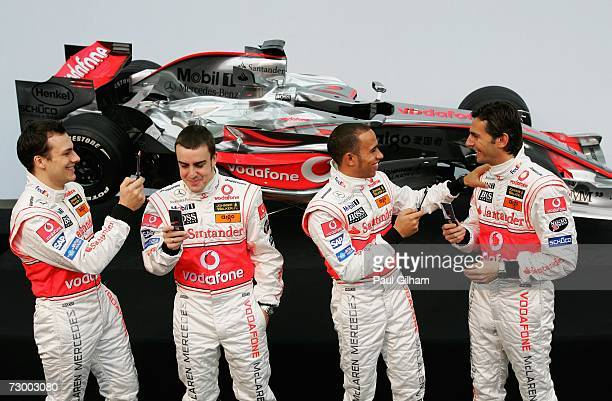 Lewis Hamilton of Great Britain takes a picture of Pedro de la Rosa of Spain while Gary Paffett of Great Britain takes a picture of Fernando Alonso...