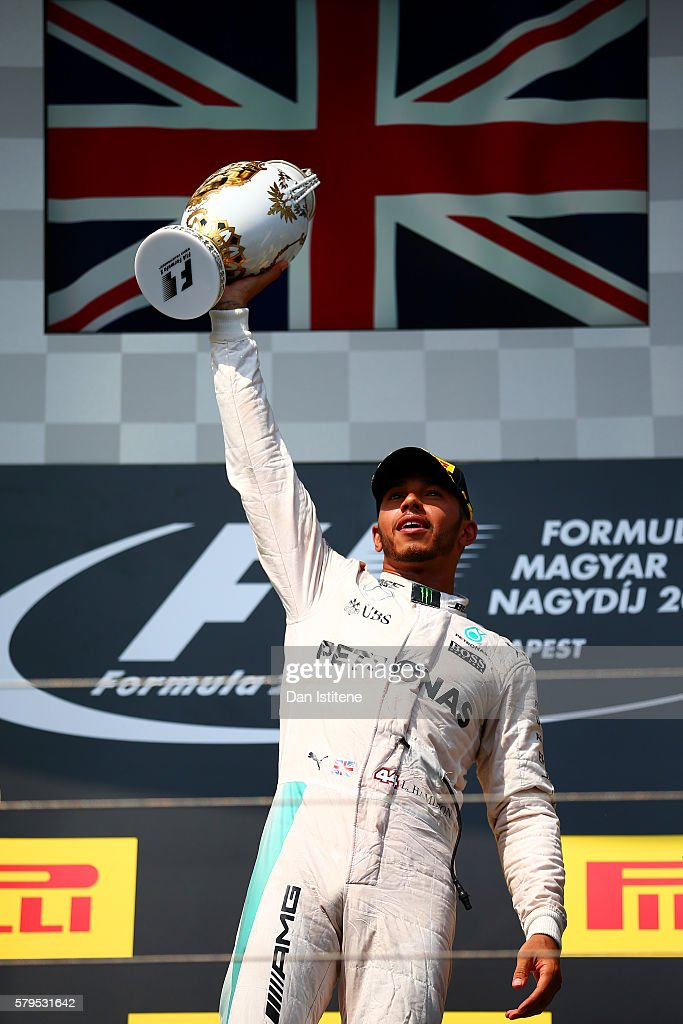 Lewis Hamilton of Greatc Britain and Mercedes GP lifts the trophy on the podium after winning the Formula One Grand Prix of Hungary at Hungaroring on July 24, 2016 in Budapest, Hungary.