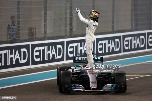 Lewis Hamilton of Mercedes AMG Petronas F1 Team celebrates on track during the Abu Dhabi Formula One Grand Prix