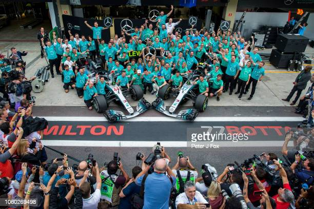 Lewis Hamilton of Mercedes and Great Britain and Valterri Bottas of Mercedes and Finland celebrate with the team for winning the 2018 Constructors...