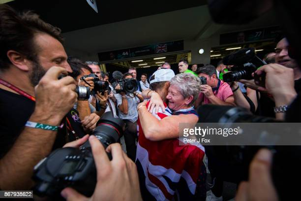 Lewis Hamilton of Mercedes and Great Britain celebrates becoming the 2017 Formula One Drivers World Champion with his Mother Carmen during the...