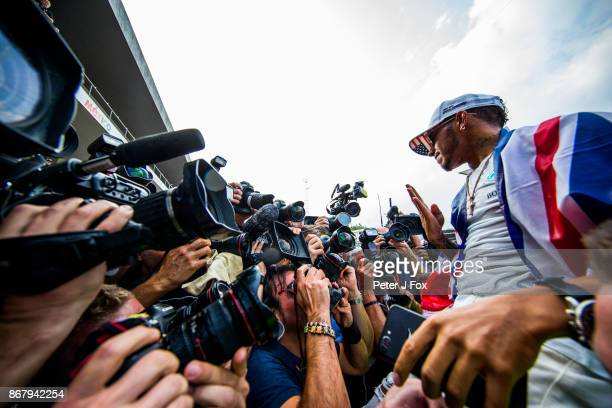 Lewis Hamilton of Mercedes and Great Britain celebrates becoming the 2017 Formula One Drivers World Champion during the Formula One Grand Prix of...