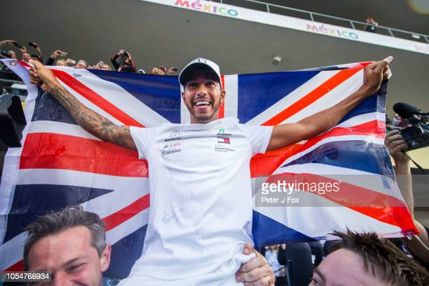 Lewis Hamilton of Mercedes and Great Britain celebrates winning his fifth Formula One World Championship during the Formula One Grand Prix of Mexico...