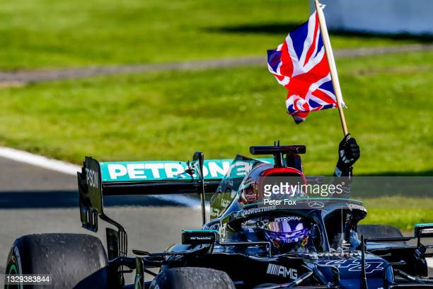Lewis Hamilton of Mercedes and Great Britain celebrates winning during the F1 Grand Prix of Great Britain at Silverstone on July 18, 2021 in...