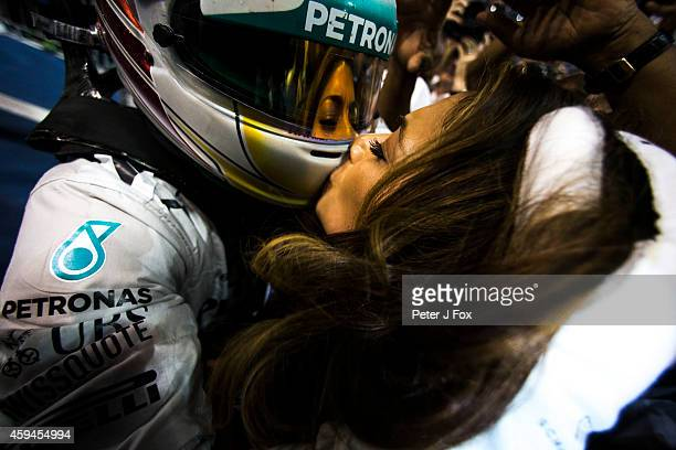 Lewis Hamilton of Mercedes and Great Britain celebrates with his girlfriend Nicole Scherzinger after winning the Formula One World Championship at...