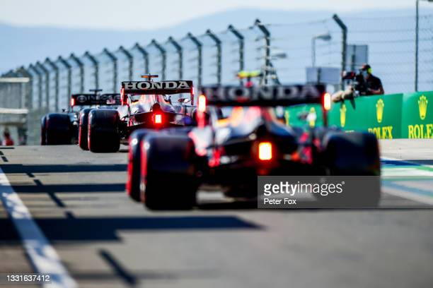 Lewis Hamilton of Mercedes and Great Britain leads Max Verstappen of Red Bull Racing and The Netherlands and Sergio Perez of Mexico and Red Bull...