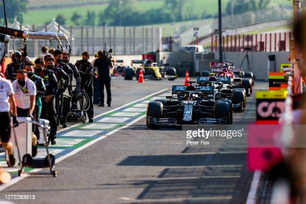 Lewis Hamilton of Mercedes and Great Britain leads the cars into the pits for the red flag during the F1 Grand Prix of Tuscany at Mugello Circuit on...